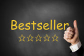 Thumbs up black chalkboard bestseller ranking — Foto de Stock