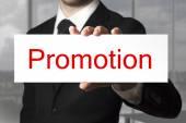 Businessman holding sign promotion — Stock Photo