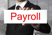 Businessman holding sign payroll — Stock Photo