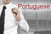 Businessman writing in the air portuguese — Stock Photo