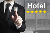 Businessman pushing button hotel five star rating — Stok fotoğraf