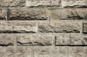 Texture of brown stone wall background structure — Stok fotoğraf