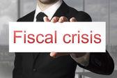 Businessman holding sign fiscal crisis — Fotografia Stock