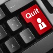 Dark grey keyboard red button quit job — Stock Photo #59418027