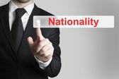 Businessman pushing button nationality — Stock Photo