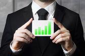 Businessman holding sign green bar diagram — Stock Photo