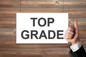 Thumbs up white canvas on wooden wall top grade — Stock Photo