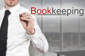 Businessman writing bookkeeping in the air — Stock Photo
