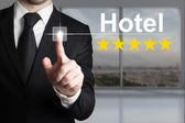 Businessman pushing touchscreen button hotel five star rating — Stock Photo