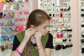 Girl chose jevelery — Stock Photo