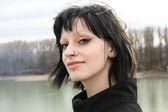 Goth Girl walks on bridge — Stock Photo