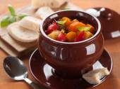 Hot goulash soup in pot with slice of bread — Stock Photo