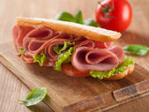 Sandwich with ham, tomato and lettuce — Stockfoto
