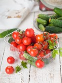 Cherry tomatoes and cucumbers in bowl — Stock Photo