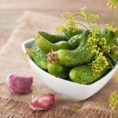 Fresh cucumbers and dill in bowl — Foto Stock