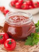 Tomato sauce with basil in glass jar — Stock Photo