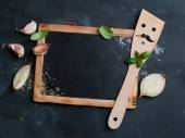 Vintage chalk board with spatula and spice — Zdjęcie stockowe