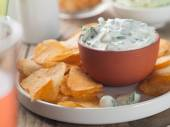 Potato chips with dip — Stock Photo