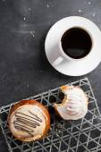 Fresh buns and cup of coffee — Stock Photo