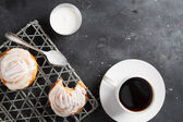 Fresh buns and cup of coffee  — Fotografia Stock