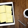 Digital tablet computer with sticky note paper and cup of coffee on old wooden desk. Simple workspace or coffee break with use of web . — Stock Photo #71830333