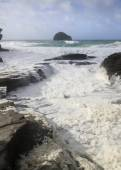 Sea foam at Trebarwith strand — Stock Photo