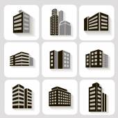 Set of dimensional buildings icons in grey and white with shadow depicting high-rise commercial   office blocks — Stock Vector