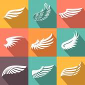 Abstract feather angel or bird wings icons set isolated vector illustration — Stock Vector