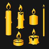 燃烧的蜡烛的黄金剪影一套 — 图库矢量图片