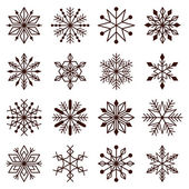 Different dark brown snowflakes — Stock Vector
