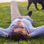 Businessman lie down on the grass ground — Stock Photo #58026121