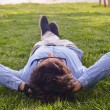 Businessman lie down on the grass ground — Stock Photo #58026211