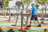Man working out on working equipment outdoors — Stok fotoğraf