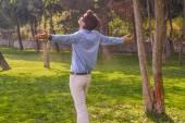 Businessman embracing the nature — Stock Photo