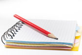 Notebook with pencil on white background — Stock Photo