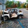Abandoned burnt down car after an explosion, ready to be scrappe — Stock Photo #66343441