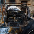 Abandoned burnt down car after an explosion, ready to be scrappe — Stock Photo #66343455