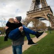 Happy smiling couple kissing in front of Eiffel Tower in Paris — Stock Photo #66351499