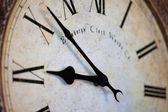 Time on vintage clock closeup — Stock Photo