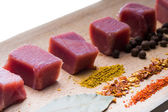 Raw meat and spices on wooden stand — Stock Photo