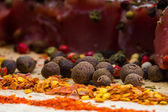 Spices and meat on lite wooden table — Stockfoto