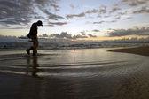Fisherman beach fly man walk — Stock Photo
