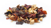 Black tea leaves with dried fruits — Stock Photo