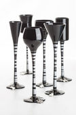 Six black coloured champagne glasses — Stock Photo