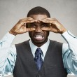 Man with disgusted face expression, looking through hand binocul — Stock Photo #52085831