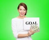 Businesswoman holding goal sign and cash, money  — Stock Photo