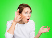 Nosy woman hand to ear gesture, trying carefully listen in on ju — Stock Photo