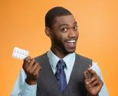 Man offering nicotine chewing gum, help with cigarette addiction — Stock Photo