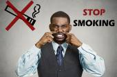 Man, pinches his nose, something stinks bad smoke smell — Stock Photo