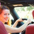 Happy woman driving her new car — Stock Photo #52152417